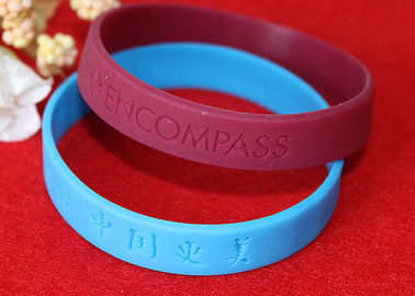 China Lettering Debossed Silicone Wristbands , Rubber Promotional Bracelets Smooth Edge distributor